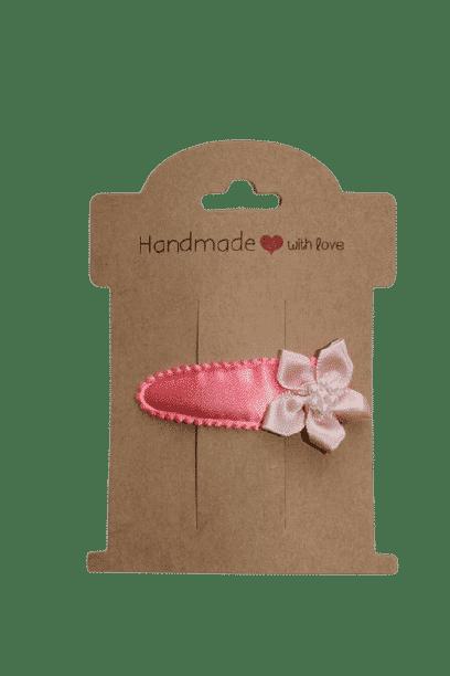 Roze haarklipje met bloem