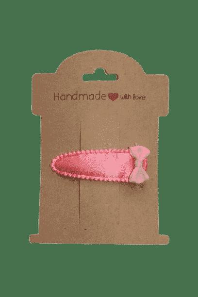 Roze haarklipje met strik